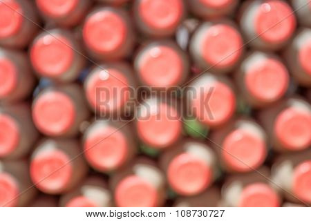 Abstract Blurred Background Of Closeup The Red Bottle Caps Arrangement.