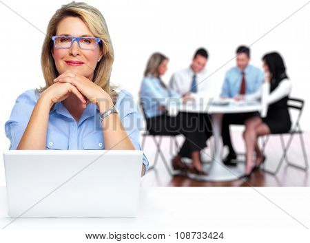 Senior business woman working with laptop computer.