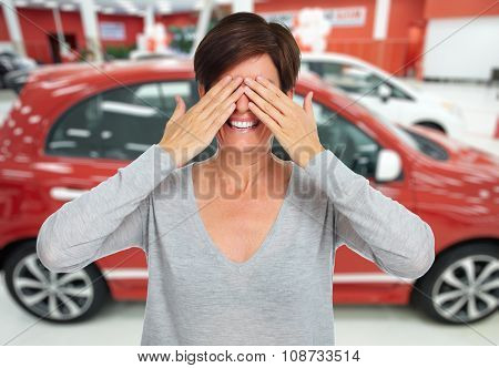 Woman hiding her face with hands. Auto dealership and rental concept background.