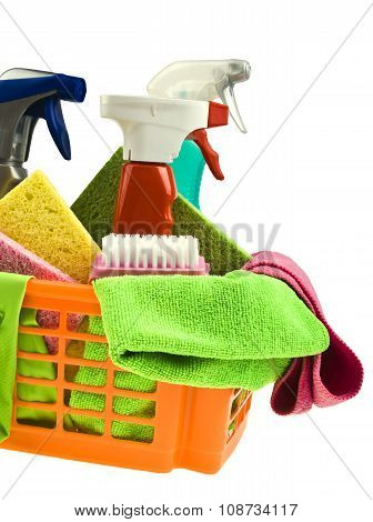 Basket with cleaning items isolated on white