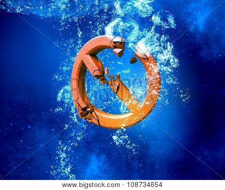 Broken stop sign sinking in clear blue water