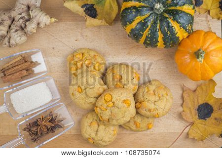 Spice pumpkin homemade cookies against wood background with ingredients