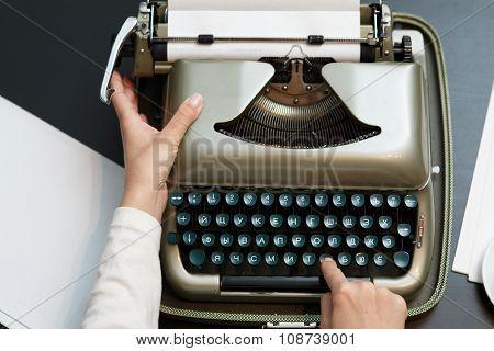 typewriter woman hands