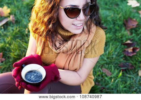 Woman Drinking Cup Of Coffee In Nature