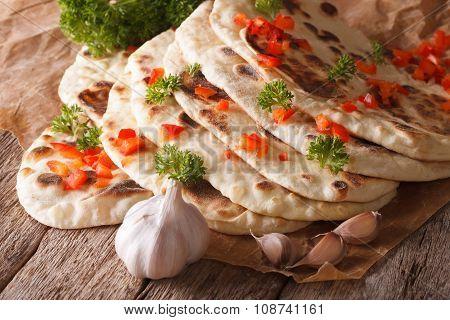 Indian Naan Flat Bread With Garlic And Herbs Closeup. Horizontal