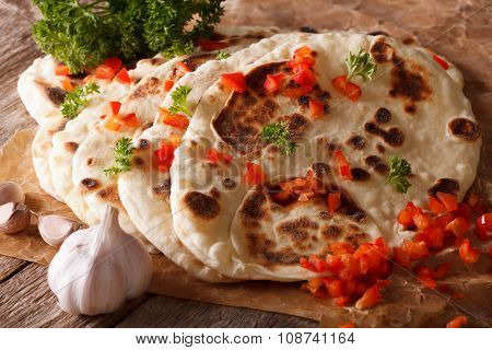 Indian Naan Flat Bread With Garlic And Pepper Macro. Horizontal