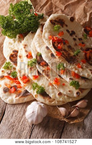 Indian Naan Flat Bread With Garlic And Herbs Closeup. Vertical