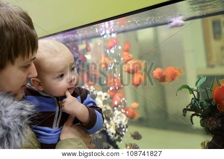 Mother With Her Baby At Aquarium
