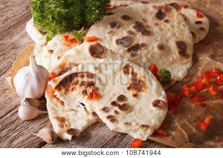 Naan Flat Bread With Garlic Close-up. Horizontal