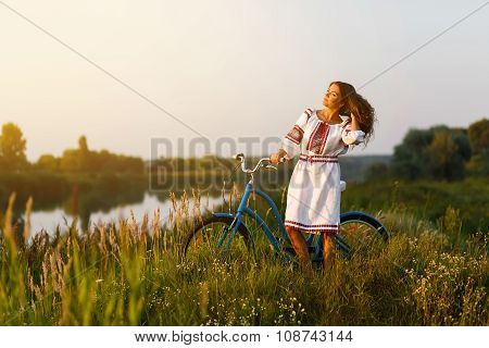 Young Woman In National Ukrainian Folk Costume With Bicycle