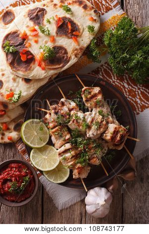 Chicken Tikka On Skewers, Naan Flat Bread Closeup. Vertical Top View