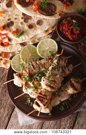 Chicken Tikka Skewers And Naan Flat Bread With Chutney Closeup. Vertical