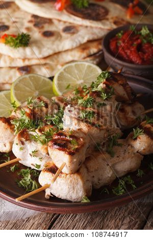Indian Chicken Tikka On Skewers Close-up And Naan. Vertical