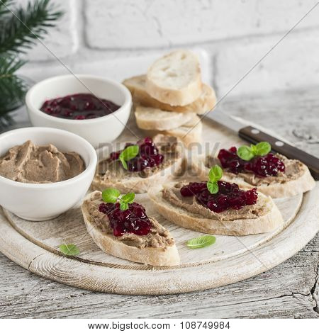 Sandwiches With Chicken Liver Pate And Cranberry Sauce, Served On A Light Wooden Board