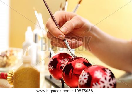 Preparation for the Christmas holidays, decorating glass ornaments