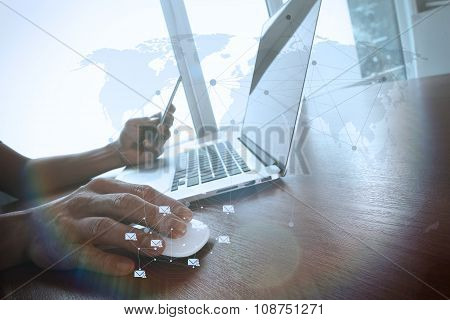 Business Man Hand Working On Laptop Computer On Wooden Desk