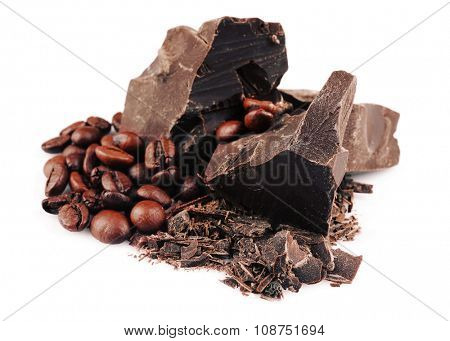 Dark chocolate pieces and shavings with coffee grains isolated on white