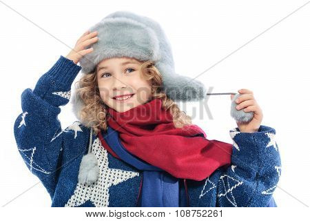 Girl wearing winter fur hat.