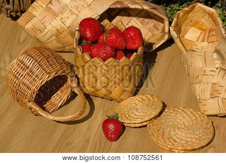 basket woven from birch bark with strawberries
