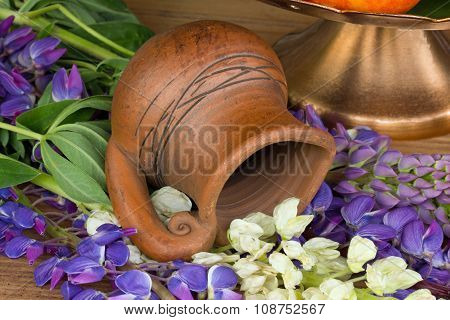 pitcher made of clay and lupins