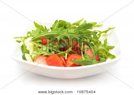 Salad From Tomatoes, Rucola, Pepper, Olive Oil On White Plate