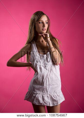 Studio photo of seductive model in nightgown