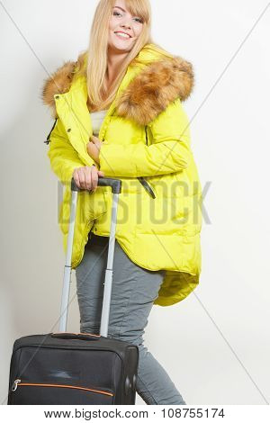 Woman In Warm Jacket With Suitcase.