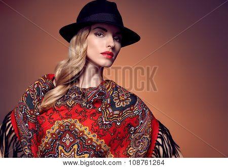 Fashion beauty woman in stylish hat shawl