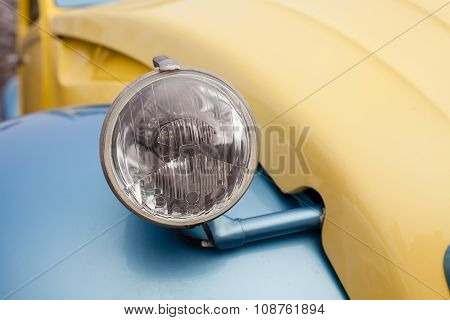 Close Up Detail Of A Vintage Car Headlight