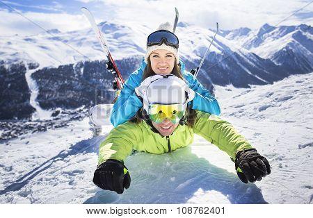 Young couple funny action winter ski resort