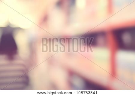 Blur Woman Shopping In Supermarket Abstract Background.