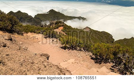 Stony Track In The Mountains Of Madeira Over Clouds