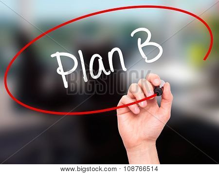 Man Hand writing Plan B with black marker on visual screen.