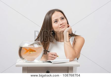 She Thought About Writing In A Notebook Desire To Fulfill A Goldfish