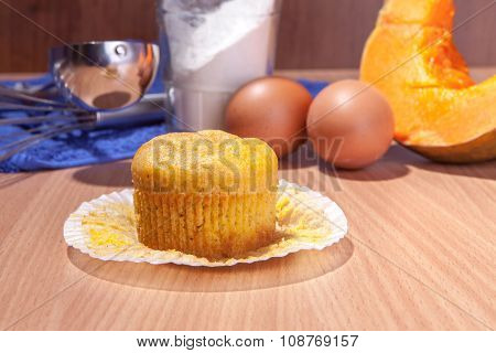 One Cupcake, Pumpkin And Baking Kitchenware On Wood Texture Table