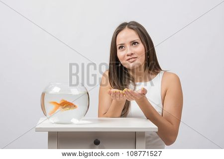 She Asks For Help From The Goldfish In The Aquarium
