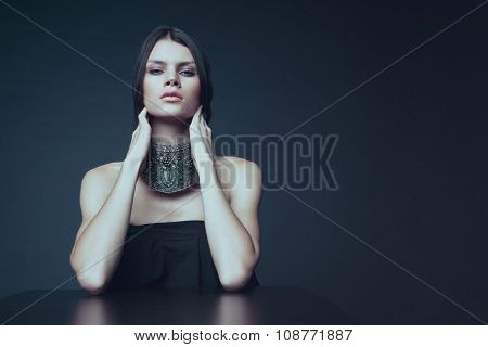 Woman in decorative silver necklace