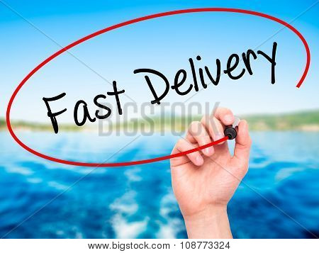Man Hand writing Fast Delivery with black marker on visual screen.