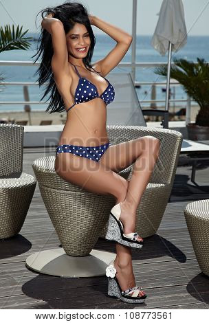 Beautiful Young Brunette In Blue Swimsuit With White Spotted