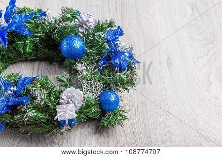 Christmas blue wreath on wood.