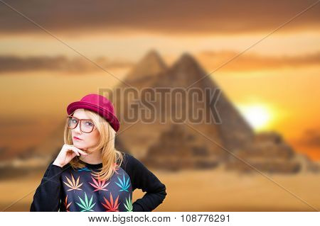 Happy young woman smiling on pyramid background