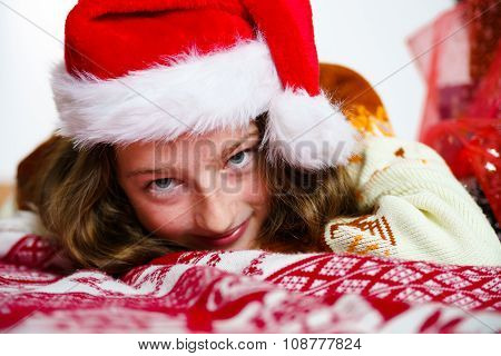Teenage Girl In Red Santa Hat Christmas Portrait