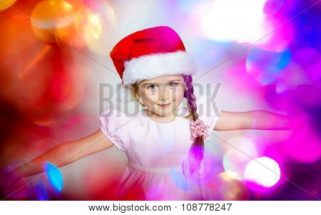 Pretty Little Girl Dressed In Santa Red Hat, New Year Portrait With Beautiful Colors