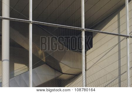 Ventilation duct behind fence