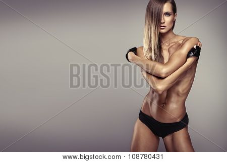 Studio Photo Of Posing Sexy Woman With Nice Fitness Body