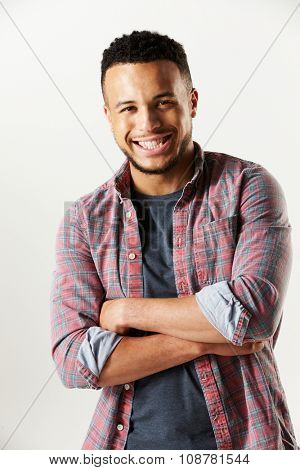 Studio Portrait Of Laughing Man Against White Background