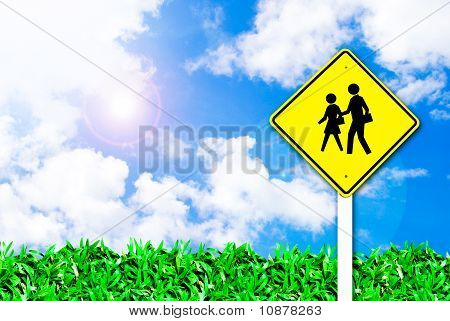 School Warning Traffic Road Sign On Beautiful Sky
