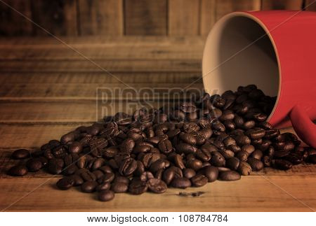 Coffee Beans And Red Cup On The Wooden Table, Concept Filter Sepia