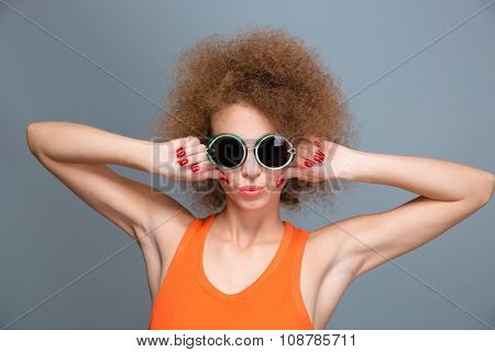 Cool confident young female posing and making grimace