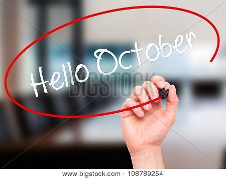 Man Hand writing Hello October with black marker on visual screen.